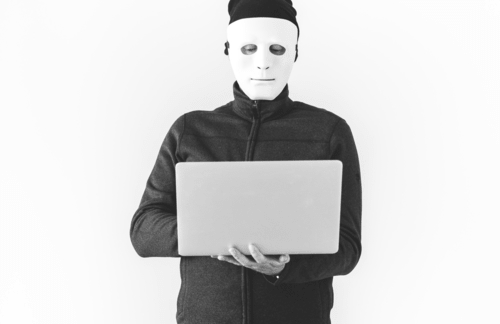 anonymous using laptop