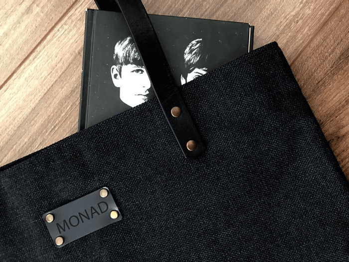 black tote monad bag and a notebook