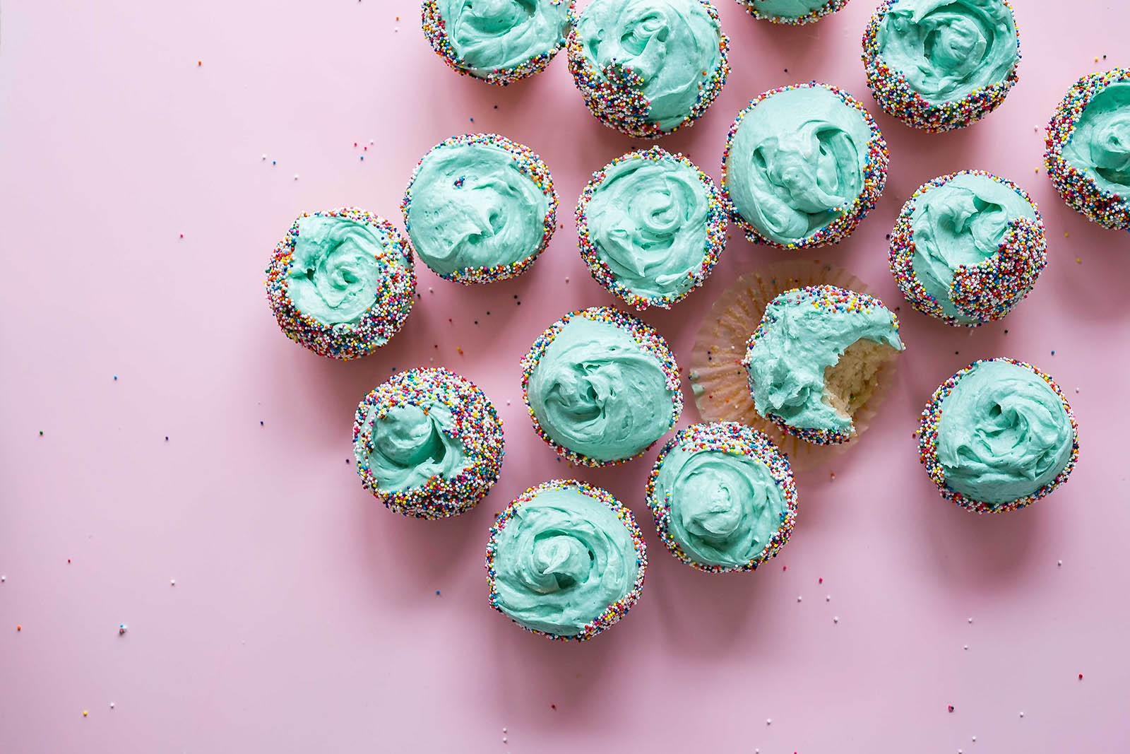 green cupcakes on pink texture